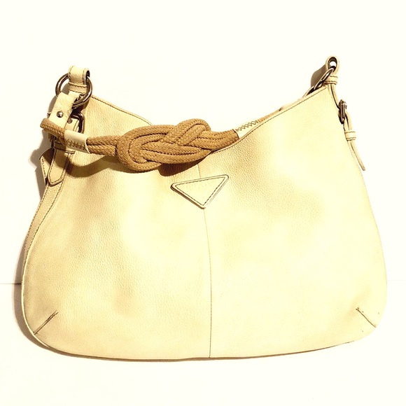 cf1464338bcb Authentic Prada beige pebbled leather handbag. M_5b3ce7f53c98440f74098616